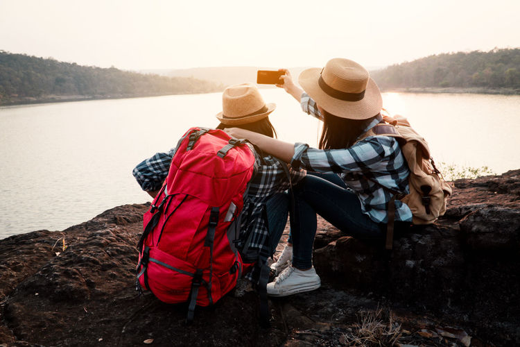 Travel Vacation Holiday Relaxing Rest Destination Nature Backpack Bag Journey Tourism Lake Leisure Activity Sitting Two People Lifestyles Smart Phone Selfie