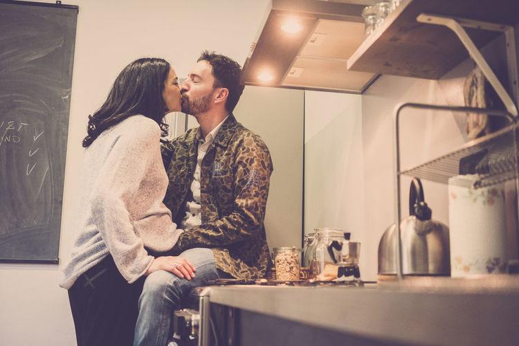Man Kissing Pregnant Woman
