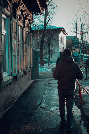 Rear View Architecture Built Structure Real People Building Exterior Men Building Lifestyles One Person City Full Length Walking Day Street Footpath Tree Standing The Way Forward Direction Outdoors Warm Clothing Alley Russia