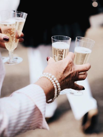 Cropped Image Of Woman Holding Champagne Flutes