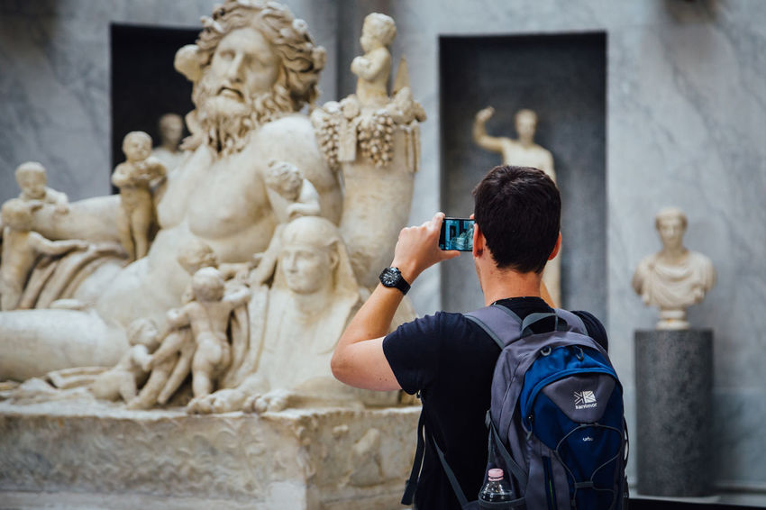 Taking Photos Architecture Built Structure Holding Human Representation Indoors  Museum One Person Photographing Photography Themes Real People Sculpture Standing Statue Vatican Museum Wireless Technology