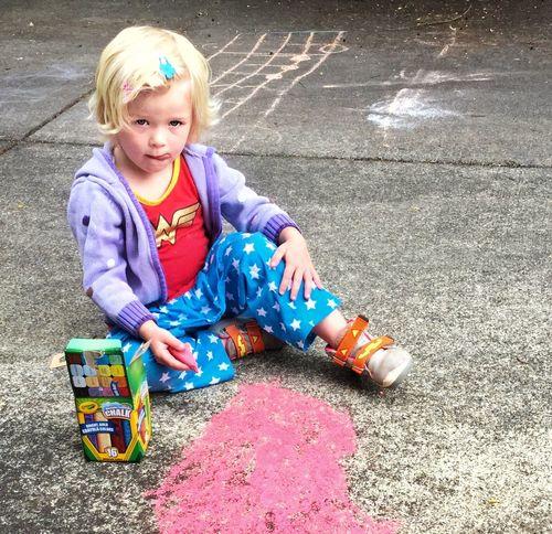 Sidewalk chalk drawing. 13048553