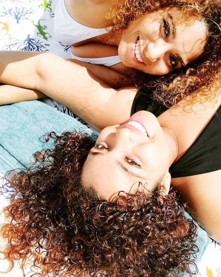 Hermanas de la vida ❤ Eyes Closed  Beauty Young Adult Relaxation Smiling Happiness Young Women Enjoyment Females Lying Down Summer Portrait Women Adults Only Long Hair Adult Beautiful Woman Cheerful Curly Hair