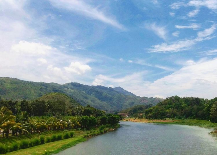Against sky Mountain Scenics Cloud - Sky Sky Mountain Range Tree Beauty In Nature River No People Landscape Outdoors Water Day Nature Rural Scene Mandailingnatal Northsumatera Wonderfulindonesia Conected Whit Travel Tranquility Photography Landscape_Collection Takenbyme Beauty In Nature Travel Destinations