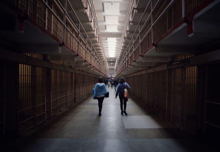 Full length of people walking in corridor