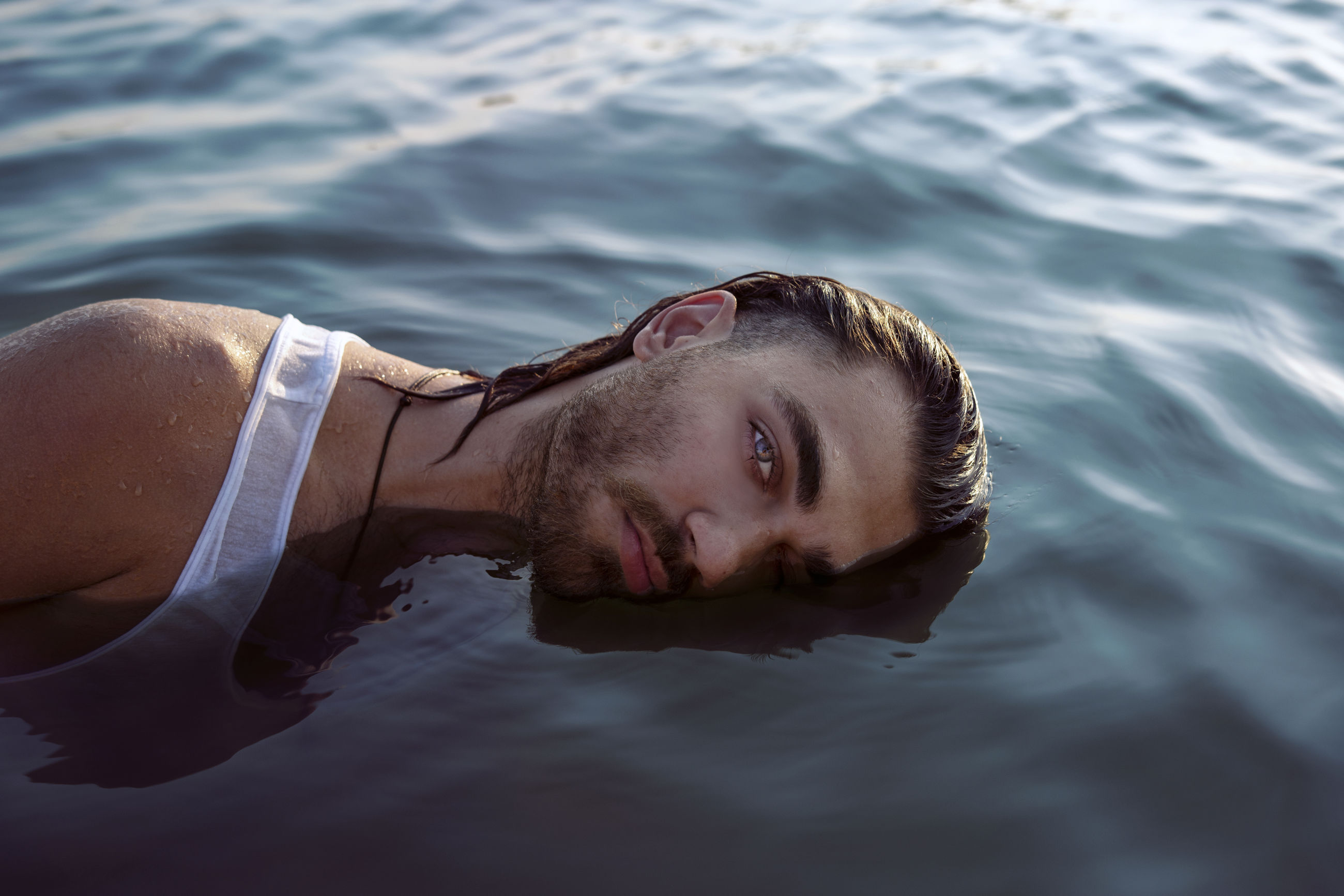 lying down, one person, young adult, relaxation, water, portrait, leisure activity, headshot, young men, real people, nature, high angle view, day, lifestyles, men, lying on back, beauty, outdoors, floating on water, beautiful woman