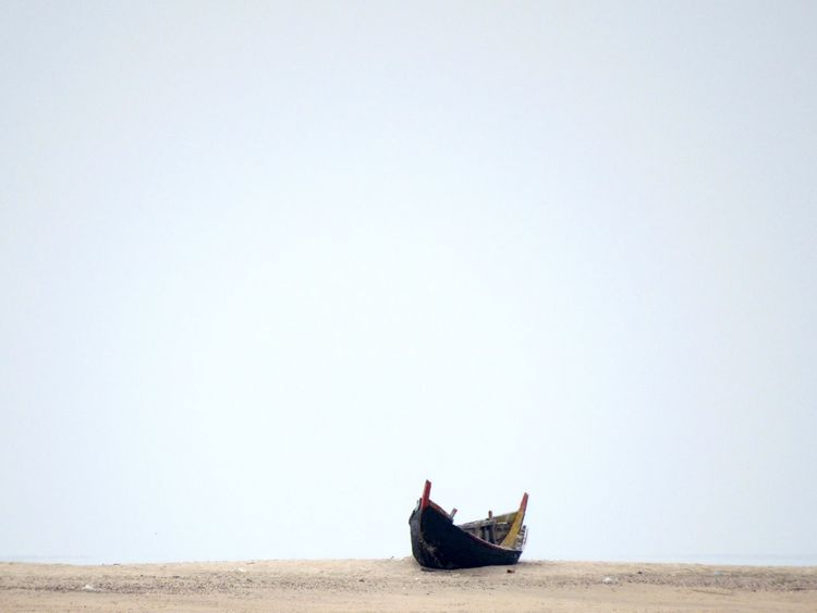 between earth and sky Beach Boat Clear Sky Loneliness Lonely Nature Naturelovers Nautical Vessel Outdoors Quite Moments Quite Place Sand Shore Side View Transportation The KIOMI Collection