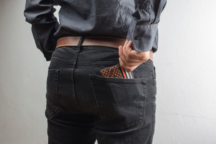 man keeping your wallet in the back pocket of his blue jean isolated on white background Wallet Man Economy Background Money Back Pocket  Pants Wealth Savings Hand Business Isolated Empty Blue Clothing Concept Leather Purchase Spend Save White Closeup Cash Buy Fashion Finance Jeans Purse Financial Currency Elégance Success Consumption  Billfold Crisis Consume Capital Capitalism Denim Inside person Male Style Shirt Rear Black Arms Behind His