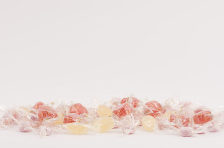hard candies Studio Shot White Background Indoors  Copy Space Close-up No People Still Life Cut Out Pink Color Large Group Of Objects White Color Softness Simplicity Food And Drink Freshness Petal Abundance Food Group Of Objects Group Hard Candy