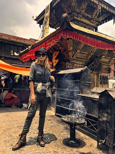 Exploration Budhist Temple Smoke - Physical Structure Front View Full Length Standing One Person Nepalese Culture Swayambhunath Monkeytemple Pilgrimage Kathmandu Ancient Ancient Civilization Standing Women Building Exterior Spirituality Religion Adventures Pet Portraits
