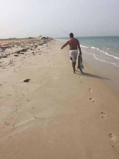 Dakhla Bay Beach Beauty In Nature Day Morocoo Nature One Man Only Outdoors Real People Sea Vacations Walking Walking Alone...