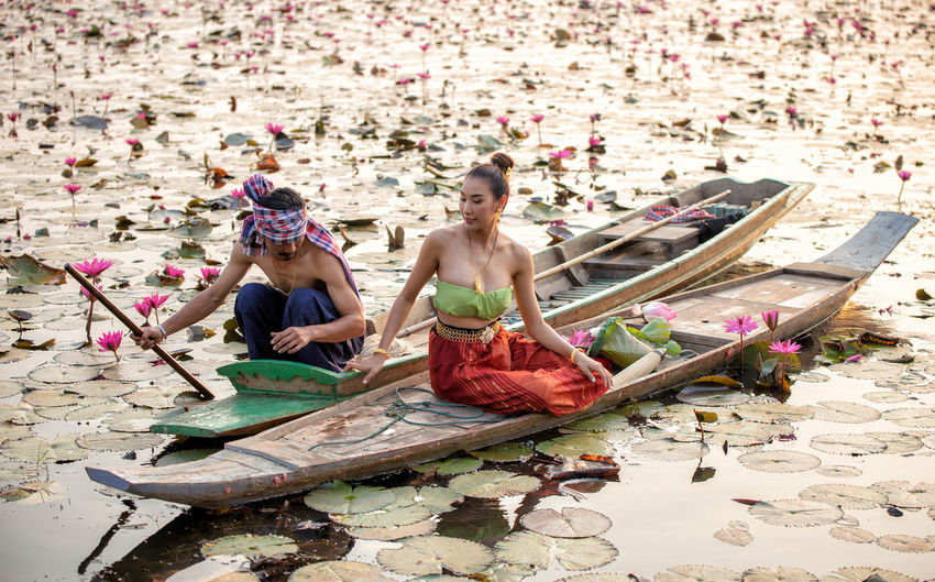 Water Flower Nature Flowering Plant Women Adult Two People Clothing Young Adult Plant People Transportation Sitting Day Females Full Length Outdoors Togetherness Beautiful Woman