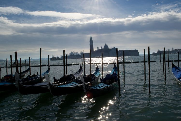 EyeEmNewHere Gondola Gondole In Venice IloveVenice Sunset Silhouettes Travelling Architecture Blue Built Structure City Gondola - Traditional Boat Ilovephotography Italy Moored Nature No People Outdoors Sea Sky Sunset Travel Travel Destinations Venice Water Waterfront