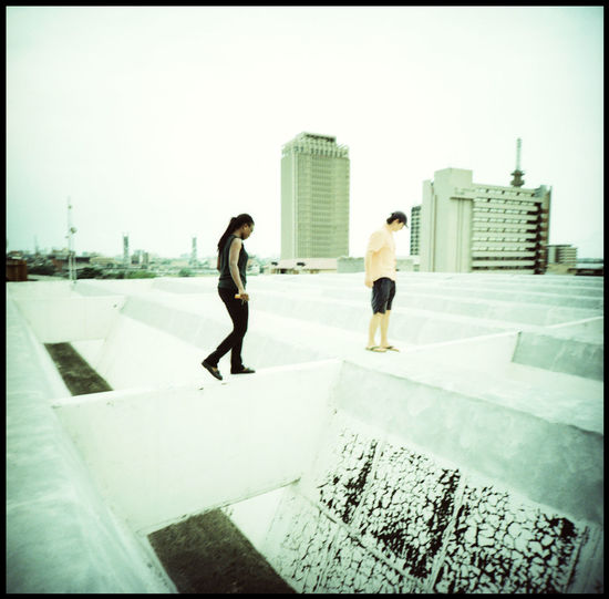 Roofing Lagos Analogue Photography Architecture Brave Couple Escalating Goethe Lagos Going Down Lagos Lomography Rooftop Travel WestAfrica Above City Africa Concrete Literally Medium Format Metropolis Outdoors Rooftop View  Walking On Roofs Xpro