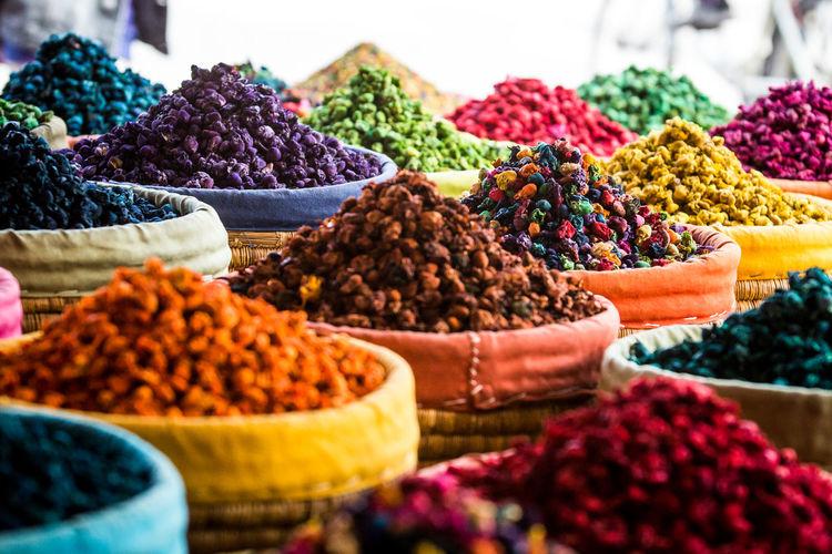 Full frame shot of colorful food in sacks for sale at market