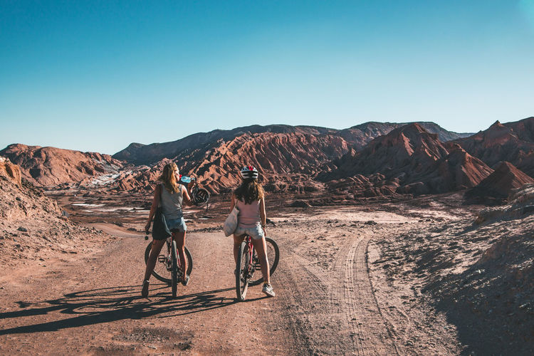 Exploring the surroundings of San Pedro de Atacama, Chile. Desert Latin America Nature Planet Earth Travel Adventure Arid Climate Bike Dry Explore Friendship Landscape Leisure Activity Mountain Outdoors Physical Geography Real People Scenics South America Sport Sunlight Togetherness Travel Destinations Women Young Adult Go Higher This Is Latin America Going Remote Visual Creativity Focus On The Story The Great Outdoors - 2018 EyeEm Awards The Traveler - 2018 EyeEm Awards Summer Sports Human Connection A New Perspective On Life Capture Tomorrow