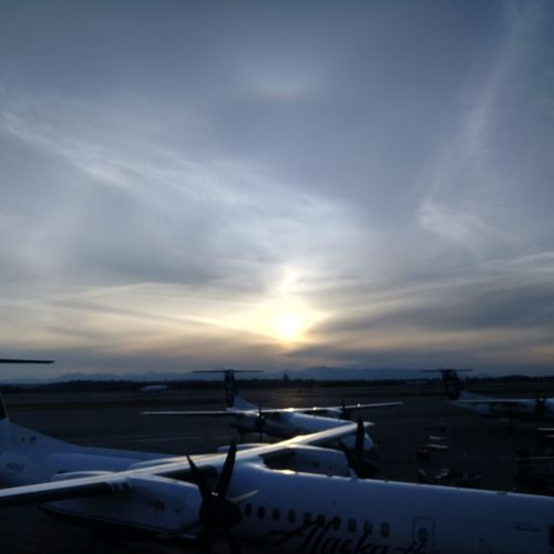 Airplane Transportation Cloud - Sky Sunset Sky Outdoors Airport Airport Runway Commercial Airplane Sun Dog Perihelion Q400 Bombardier Bombardier Q400 river Alaska Aerial View Wanderlust Headintheclouds Alaska Air