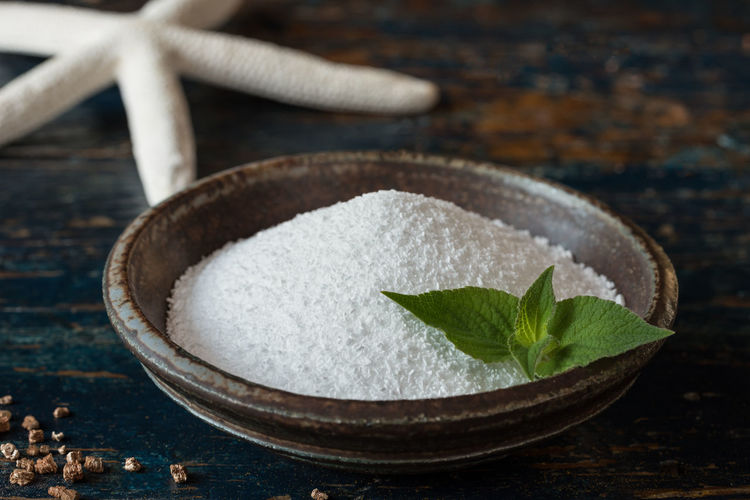 Close-Up Of Epsom Salts In Bowl On Wooden Table