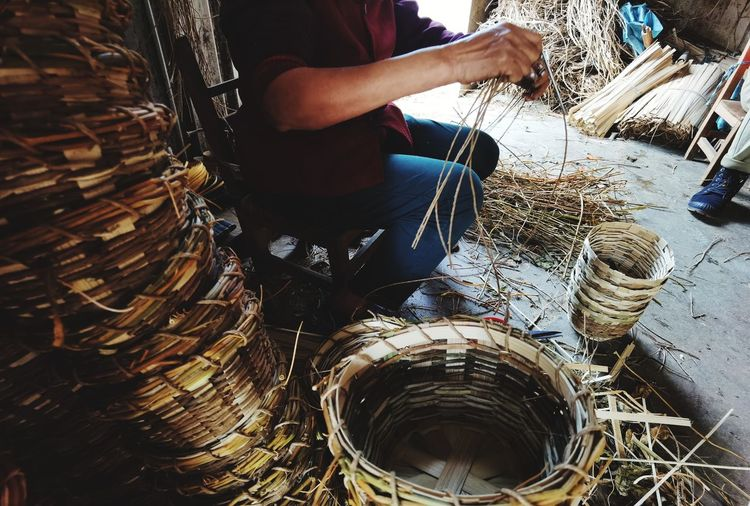 Low section of man working in basket