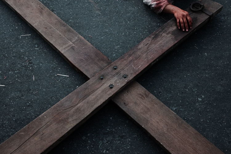 High angle view of man in blood lying on cross