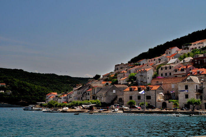 Architecture Beatiful Building Exterior Calm Croatia Day Mountain Nautical Vessel No People Outdoors Sky Small Village Travel Destinations Tree Vacations Village Village Life Water Water Reflections Wave