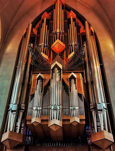 Hallgrimskirkja, reykjavik. church organ at sunset. musical instrument