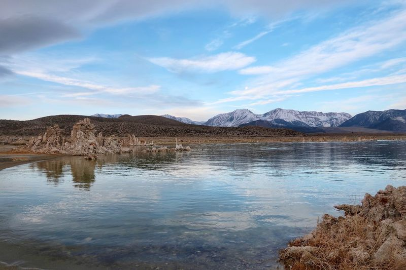 Landscape of Mono Lake, hills, mountains and tufa formations Tufa Mono Lake Landscape Water Sky Mountain Cloud - Sky Scenics - Nature Beauty In Nature Day Lake Tranquility No People Tranquil Scene Land Mountain Range Non-urban Scene Outdoors Environment Waterfront Shallow Nature Reflection