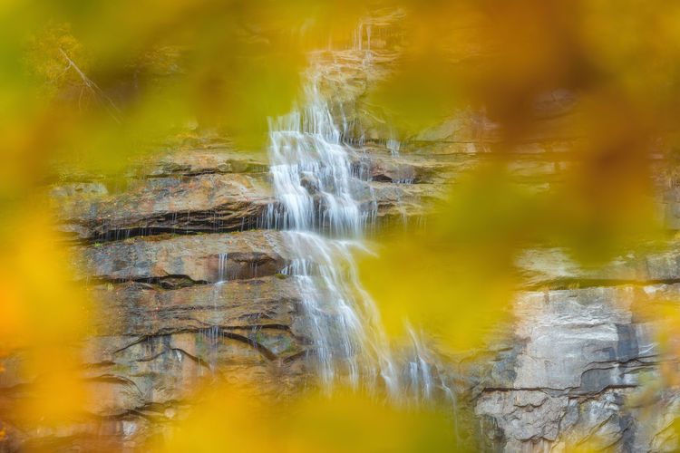 Close-up of waterfall against blurred background