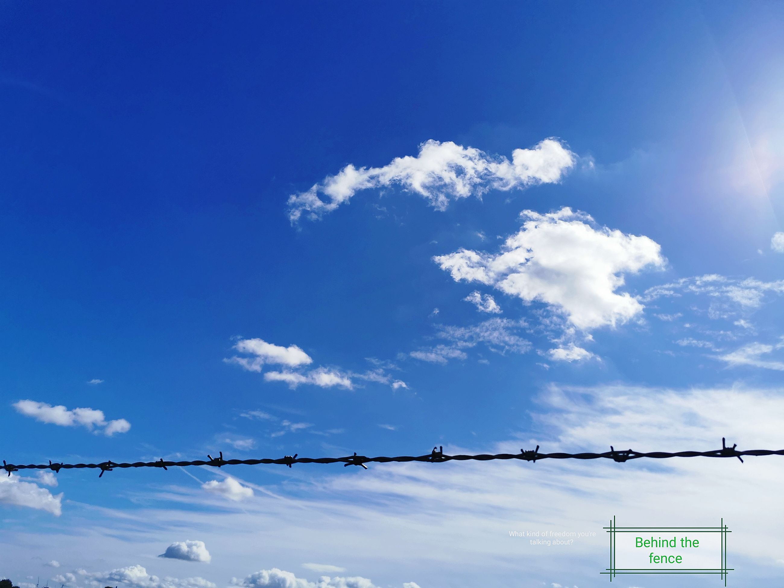 sky, cloud, blue, nature, communication, sunlight, sign, no people, electricity, day, cable, outdoors, horizon, low angle view, technology, text, copy space, guidance, architecture