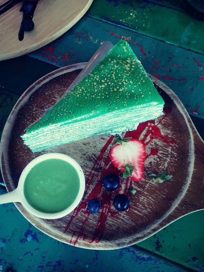 """Macha crepe cake at """"Is Sweet"""" Cafe in Las delicious and a very relaxing and quiet to come here to eat some savory sweets😋. Crêpes Crepe Cake Macha Green Tea Green Tea ❤️ Cake Cake Time Dessert Dessert Porn Cafe Time Delicious Sweets Pastry Flavor Art Dish Eating Baked Pastry Item High Angle View Close-up Prepared Food Slice Of Cake Tart - Dessert"""