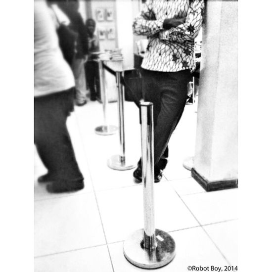 The Wait. A customer waits in a queue for his turn. Photo: Enoch 'Robot Boy' Appiah Jr. (©2014) Location: Barclay's Bank (Krofrom Branch), Kumasi AndroidPhotography Androidography Monochrome noFilter KumasiInsta photoWalk