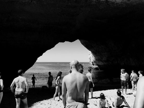 Mix Yourself A Good Time Beach Real People Men Large Group Of People Women Sea Sand Shirtless Rock - Object Vacations Leisure Activity Outdoors Nature Water Lifestyles Day Sky Standing Togetherness Beauty In Nature Shadow Back Nature Benagil, Algarve,Portugal Connected By Travel Black And White Friday