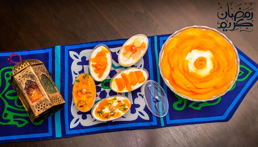 Konafa Blue Close-up Directly Above Food Food And Drink Freshness Fruit Healthy Eating High Angle View Indoors  Japanese Food No People Orange Orange Color Plate Ready-to-eat Snack Still Life Table Text Tray Wellbeing Wood - Material