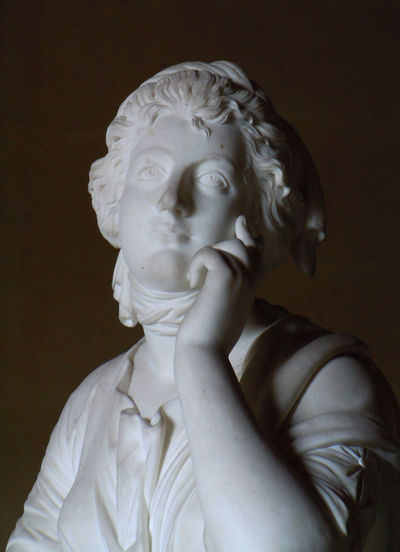 Statue against wall in museum