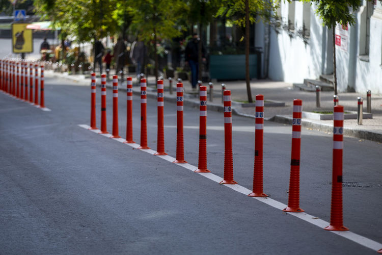 Row of red cart on street in city