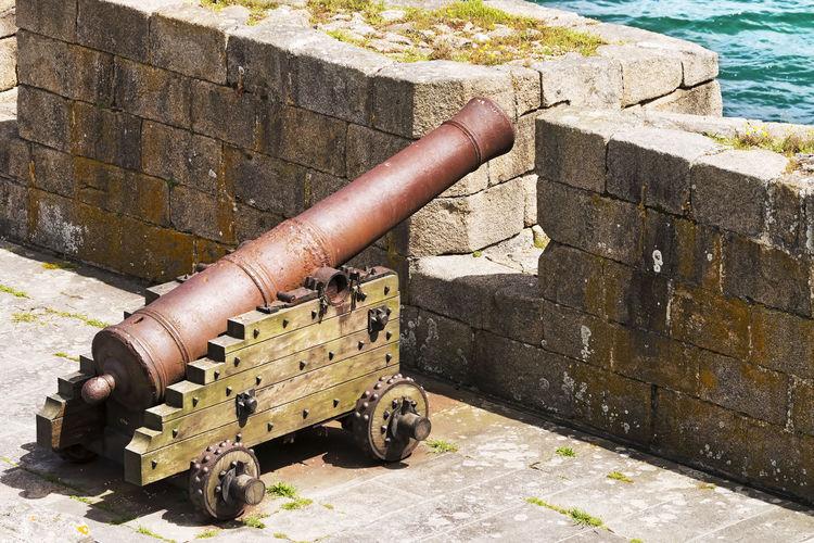 old cannon in fortness , San Anton castle , Coruna , Coruña, Galicia , Spain Fort Architecture Military History Hercules Heritage Unesco Sea Atlantic Voyage Tourist Tourism Galicia Coruña Cannon Metal Tank Stone Wall Fortress