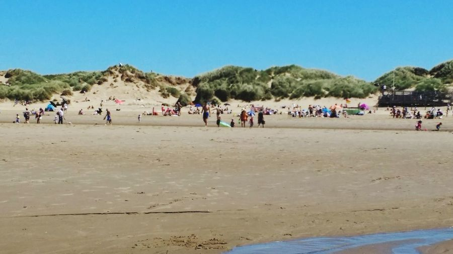 Sand Beach Outdoors Large Group Of People Day Clear Sky Blue Formby Beach View In Distance Hot Sunny Day Lots Of People Lots Of Fun View From Sea Paddling In Sea