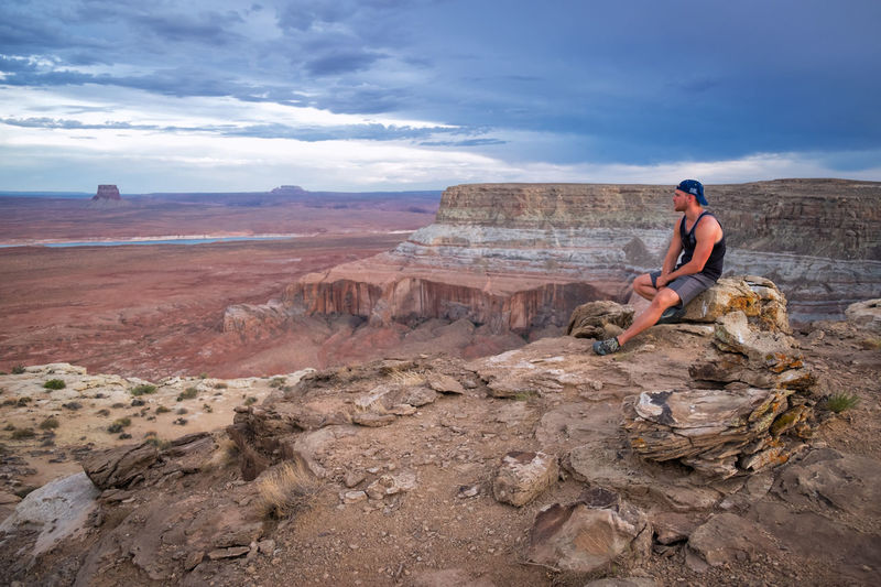 My son's friend takes in the beauty of Alstrom Point near Page, AZ. Alstrom Point Page AZ Activity Adult Adventure Beauty In Nature Cloud - Sky Day Full Length Land Leisure Activity Lifestyles Mountain Nature One Person Outdoors Real People Rock Rock - Object Rock Formation Sky Solid The Great Outdoors - 2018 EyeEm Awards