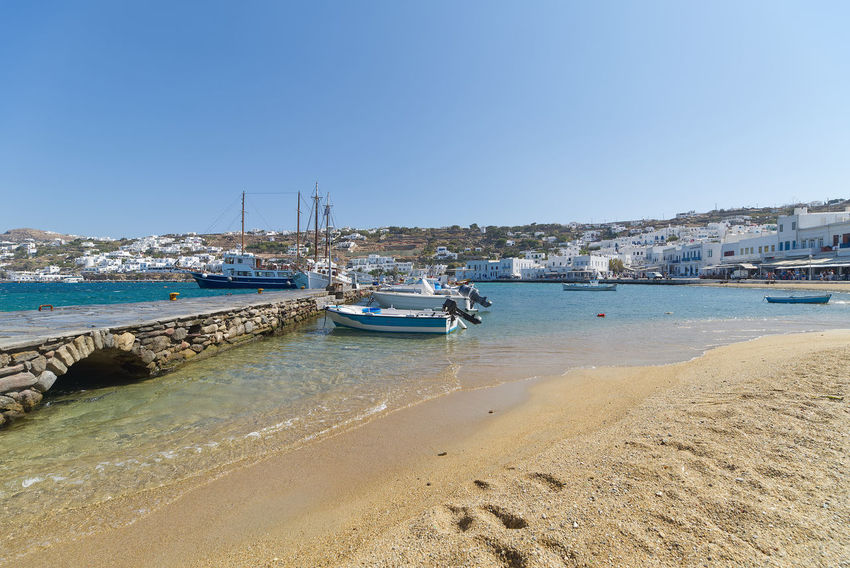 Chora village ( Beach and harbor ) - Mykonos Cyclades island - Aegean sea - Greece Aegean Chora Architecture Beach Boat Clear Sky Coast Cyclades Day Greece Island Land Luxury Mykonos Nature Outdoors Port Sea Seascape Ship Shore Shoreline Sky Village Water