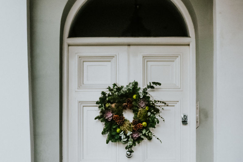 Holiday Arch Architecture Building Building Exterior Built Structure Celebration Christmas Christmas Decoration Closed Day Decoration Door Entrance Green Color Nature No People Outdoors Plant White Color Window Wreath