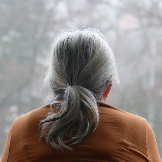 Rear view of woman against blurred background