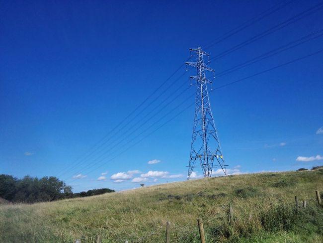 Electricity  Blue Electricity Pylon Power Supply Power Line  Landscape Clear Sky Electricity Tower Grassy