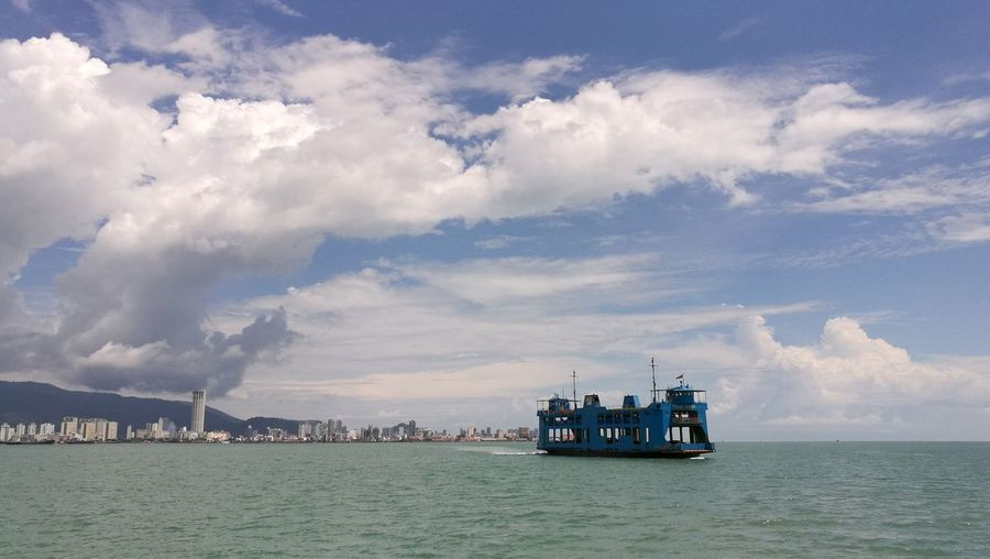 Penang Ferry On Sea Against Cloudy Sky