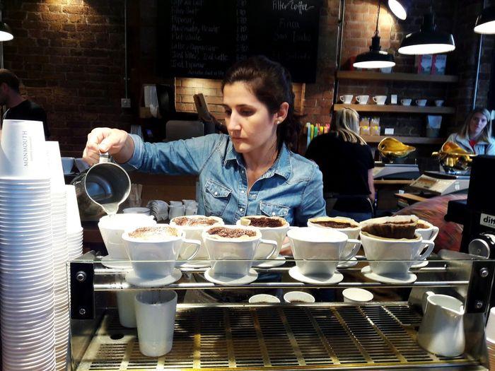 Woman having coffee in restaurant