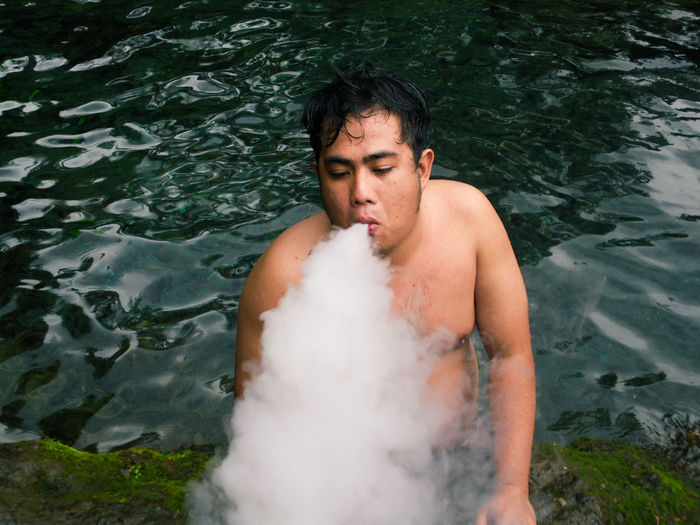Young Man Blowing Smoke