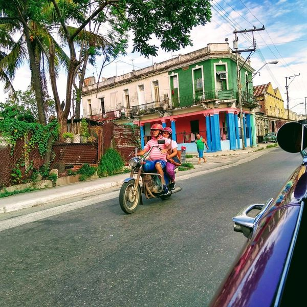 Carribean Havana Cuba The Street Photographer - 2018 EyeEm Awards Men Land Vehicle Bicycle Road Motorcycle Women Riding Sky Architecture Building Exterior Scooter Motor Scooter Street Motorbike