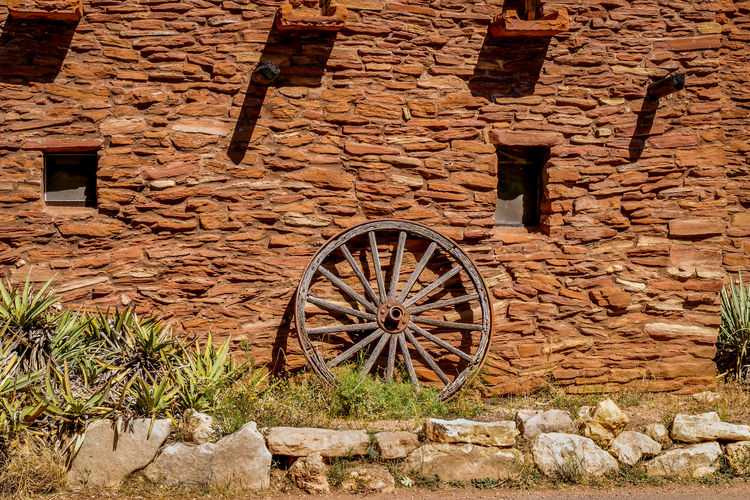Wagon Wheel Against Brick Wall