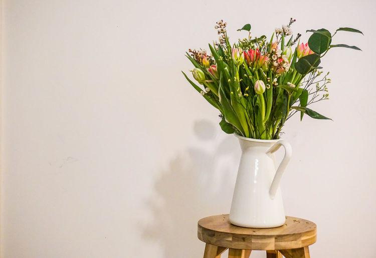 Close-Up Of Vase On Stool