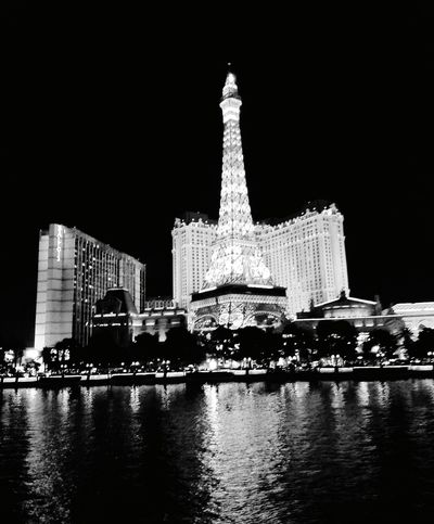 Black And White Friday Travel Destinations Illuminated Reflection Cityscape Skyscraper Las Vegas NV Blackandwhite Photography Las Vegas Leisure Time Night Architecture Built Structure Building Exterior Water City Modern No People Paris Hotel And Casino París Hotel-Las Vegas, Nevada Vacations