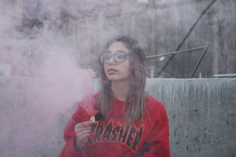 Portrait Of Young Woman In Pink Smoke